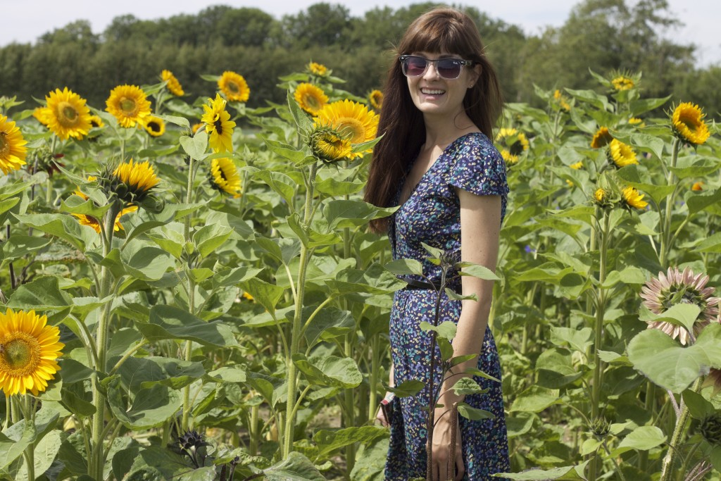 smiling with sunflowers