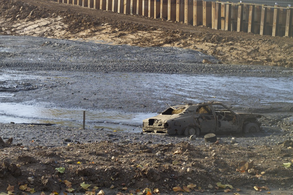 car in the drained pond