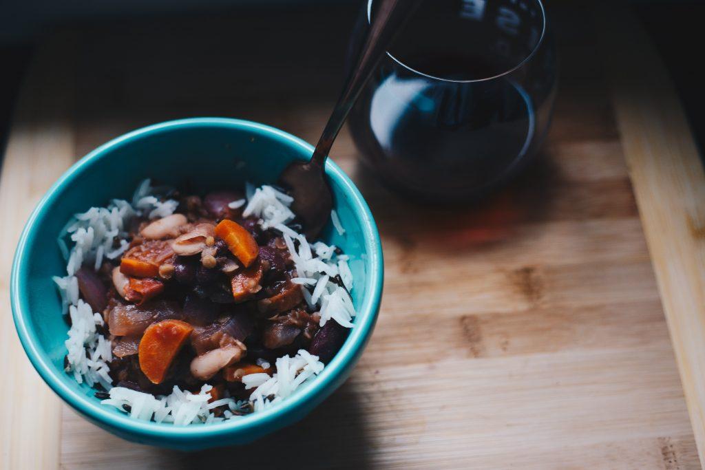 bowl of vegan food and wine