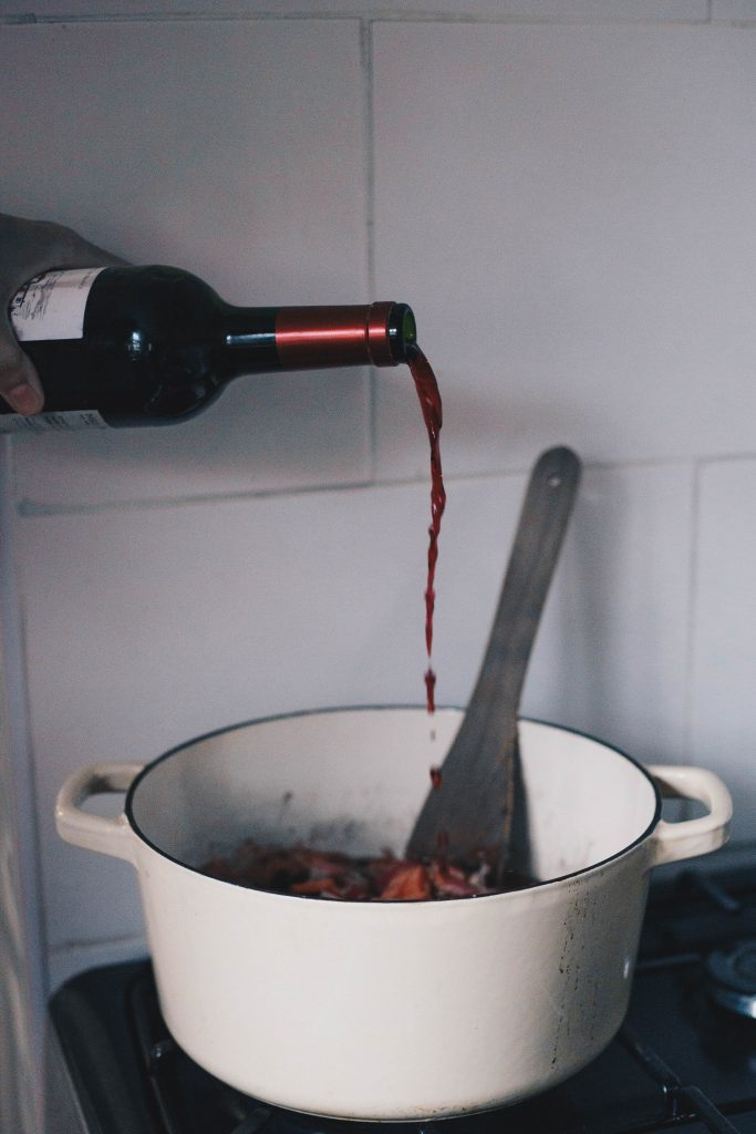 pouring in red wine